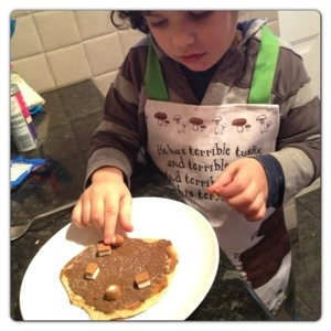 Little man Decorating his Pancake