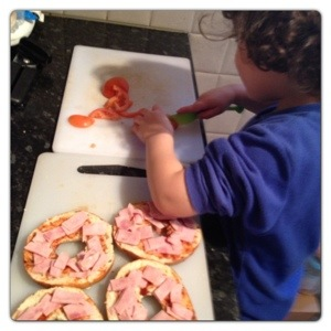 Little Man Making Pizza Bagel