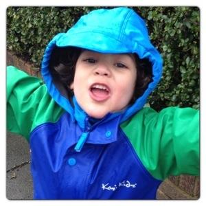 Little Man Loving the Rain!